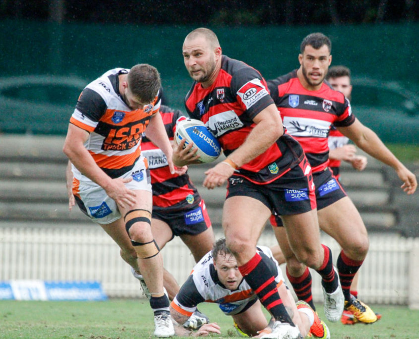 At prop for the Bears Robbie Rochow breaks away from the Wests Tigers defence. Photo Steve Little www.redandblackzone.com.