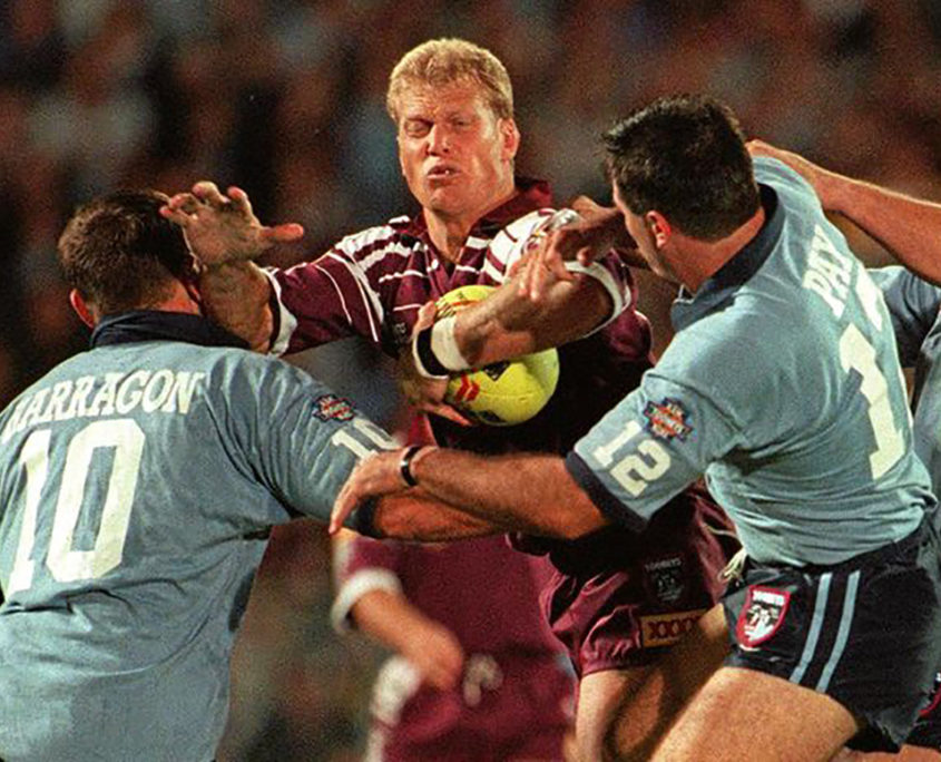 Image: GLORY YEARS: Gary Larson in attack against Paul Harragon and Dean Pay in Game I of the 1996 series. Geoff McLachlan
